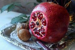 Ripe pomegranate  on a platter Stock Photography