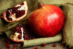 Ripe pomegranate with red seeds Stock Photo