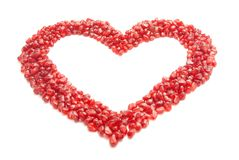 Ripe pomegranate seeds in form of heart Stock Images