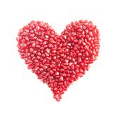 Ripe pomegranate seeds in form of heart Stock Image