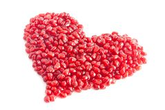 Ripe pomegranate seeds in form of heart Royalty Free Stock Photo