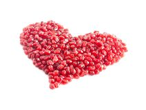 Ripe pomegranate seeds in form of heart Royalty Free Stock Photos