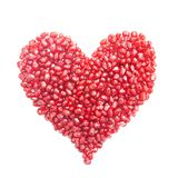 Ripe pomegranate seeds in form of heart Royalty Free Stock Images