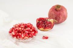 Ripe pomegranate on white background Royalty Free Stock Images