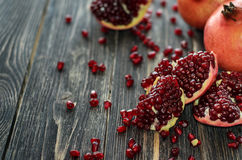Ripe pomegranate on the wooden background Stock Images