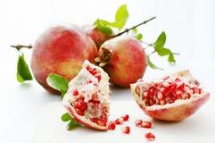 Ripe pomegranates. Red ripe pomegranates, hole and half Stock Images