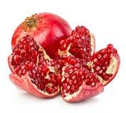 Ripe pomegranates close-up on a white background. Stock Photo