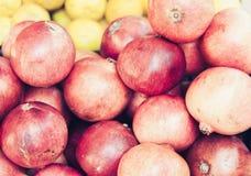 Ripe pomegranates in the fruit market, Catania, Sicily, Italy royalty free stock photo