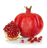 Ripe pomegranates isolated on a white Stock Images