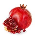 Ripe pomegranates isolated on a white Royalty Free Stock Photos