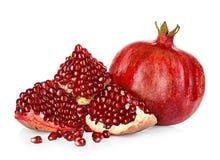 Ripe pomegranates isolated on a white Stock Image