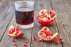 Ripe pomegranates with juice Royalty Free Stock Photo