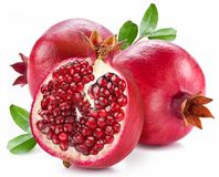 Ripe pomegranates with leaves. Stock Photography