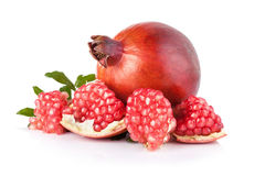 Ripe pomegranates with leaves isolated on a white background Stock Image