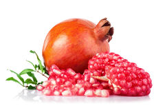 Ripe pomegranates with leaves isolated on a white background Stock Photo