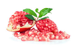 Ripe pomegranates with leaves isolated on a white background Stock Photography