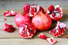 Ripe pomegranates loose on a table Royalty Free Stock Photography