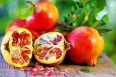 Ripe Pomegranates on table Stock Photos