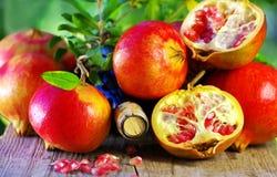 Ripe Pomegranates on table Royalty Free Stock Photography