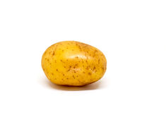 Ripe potato on white background. Brown and yellow vegetable isolate image. Stock Photos