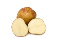 Ripe potatoes. Ripe potato and two halves. Isolated on white Stock Images