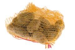 Ripe potatoes in burlap sack Stock Images