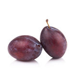 Ripe prune or plum isolated on a white background.  Stock Photos