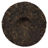 Ripe puerh cake backside isolated Stock Images