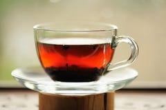 Ripe puerh tea brewed in glass cup Stock Photo