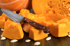 Ripe pumpkin cut into pieces Stock Images