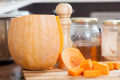 Ripe pumpkin on  cutting board Stock Image