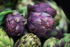 Ripe purple artichoke on the local vegetables market stock photos