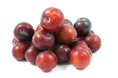 Ripe purple cherry plums isolated. On white Stock Photos