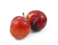 Ripe purple cherry plums isolated. On white Royalty Free Stock Image