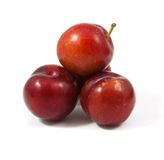 Ripe purple cherry plums isolated. On white Royalty Free Stock Photography