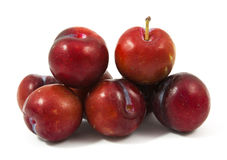 Ripe purple cherry plums isolated. On white Royalty Free Stock Photo