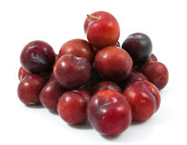 Ripe purple cherry plums isolated. On white Stock Photo