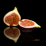 Ripe purple fig fruit cut in half Royalty Free Stock Image