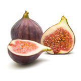 Ripe purple fig fruits. One cut in half; isolated stock photography