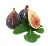 Ripe purple fig fruits  and leaf. Ripe fresh purple fig fruits  and leaf on white background Royalty Free Stock Photos