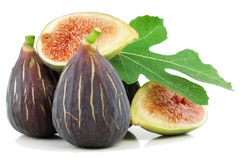 Ripe purple fig fruits  and leaf. Ripe fresh purple fig fruits  and leaf on white background Royalty Free Stock Photography