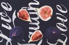Ripe purple figs on black background. Top view Royalty Free Stock Photos