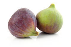 Ripe purple and green fig fruit isolated Royalty Free Stock Photos