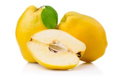 Ripe quince fruits with leaf and slice isolated Royalty Free Stock Images