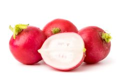 Ripe radish and half on a white background. royalty free stock photography