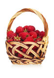 Ripe raspberries. In a wicker basket on white background Royalty Free Stock Photos