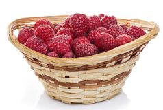 Ripe raspberries in basket with mint on white. Ripe raspberries in basket with mint isolated on white Royalty Free Stock Image