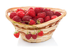 Ripe raspberries in basket with mint on white. Ripe raspberries in basket with mint isolated on white Stock Images
