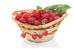 Ripe raspberries in basket with mint on white. Ripe raspberries in basket with mint isolated on white Stock Image