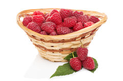 Ripe raspberries in basket with mint on white. Ripe raspberries in basket with mint isolated on white Royalty Free Stock Photography